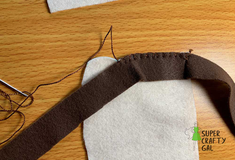 Shows how to follow the curve of the bread while sewing