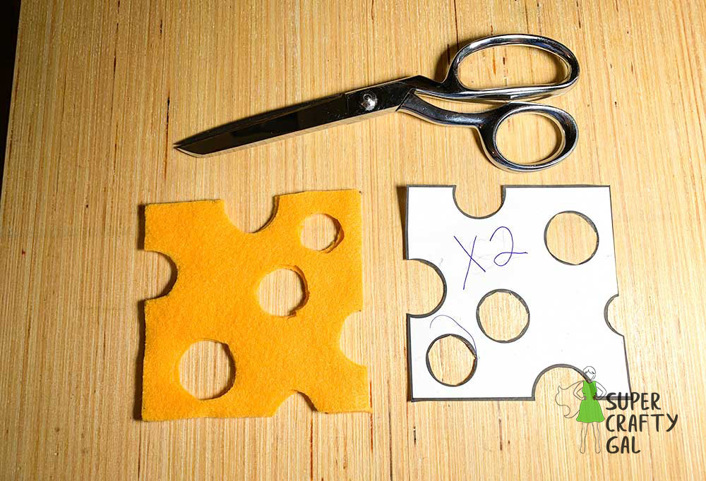 felt cheese cut to pattern with silver pair of scissors