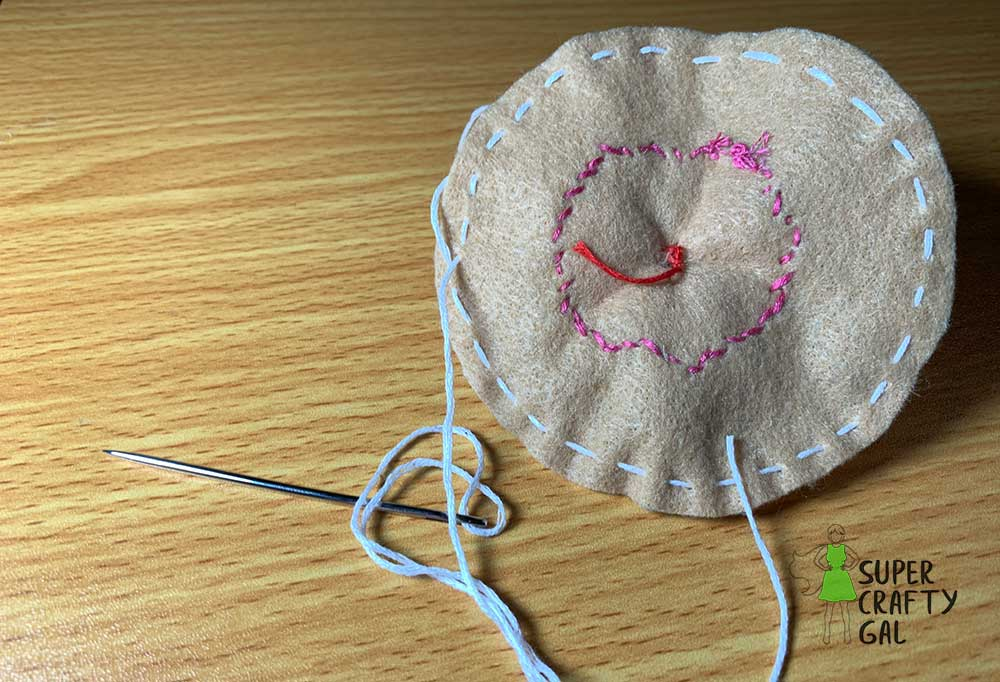 sewing drawstring into edge of cupcake top