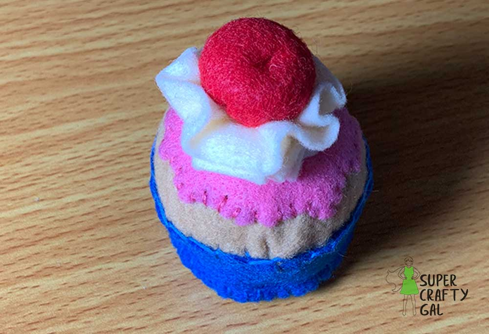 Finished felt cupcake with cherry on top