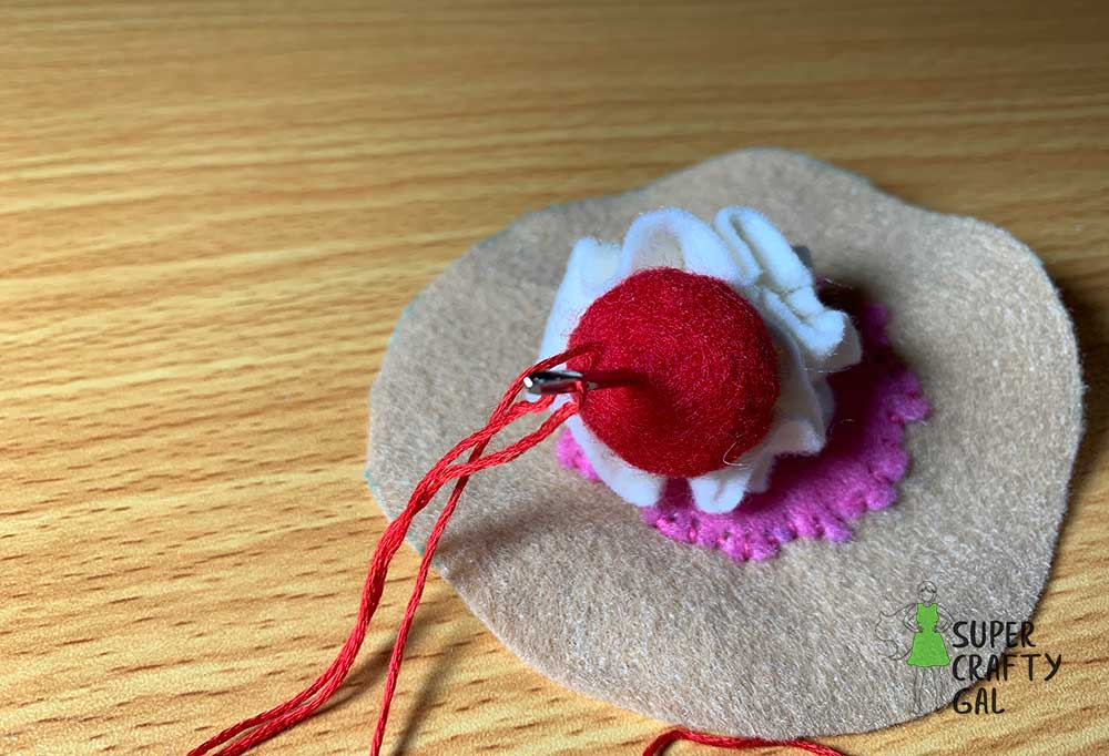 sewing cherry on cupcake top