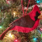 Felt Cardinal Christmas Ornament on a lit Christmas Tree