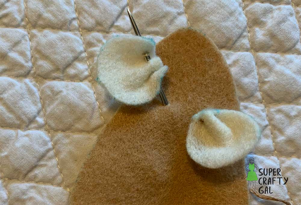 sewing the 2nd ear onto the felt mouse body