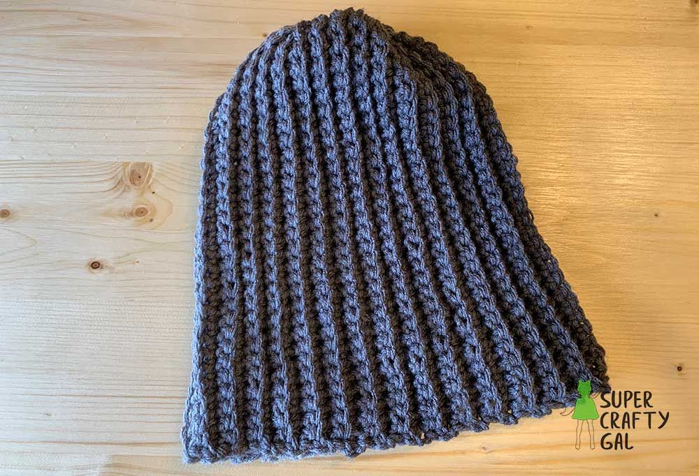 Beanie hat isolated on wooden table