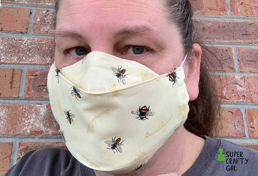 Woman wearing 3d face mask with bumblebee printed fabric