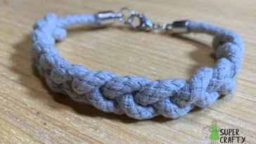 Rope bracelet with silver clasp on a wooden table