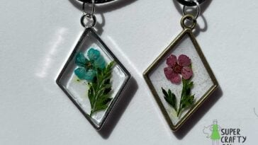 Flower in resin bezel necklaces on a white background
