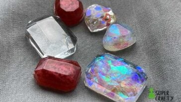 Colorful gems made from UV resin on a grey piece of fabric